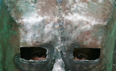 IMAGE: Luis Aldana wears an iron mask