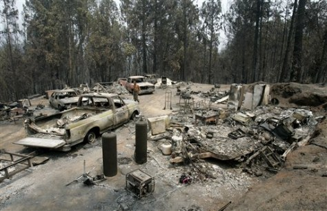 IMAGE: ASHES, DEBRIS AT HOME SITE