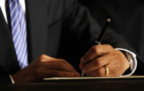 Image: Obama signing legislation