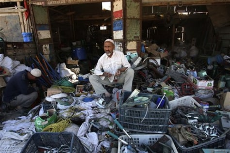 Image: A Uighur man tends his junk shop
