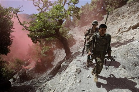 Image: Afghan and U.S. soldiers dodge red smoke