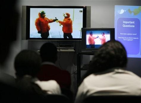 Image: Students watch teacher in Antarctica on TV