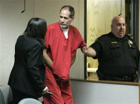 Image: Phillip Garrido, center, talks with attorney Susan Gellman