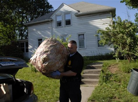 IMAGE: POLICE TAKE EVIDENCE FROM HOME