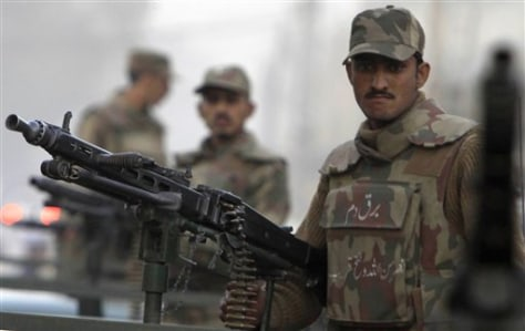 Image: Pakistani army troops stand guard