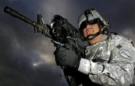 Image: U.S. Army Staff Sgt Ruben Romero, from Fort Benning, Ga., demonstrates new technology on the M4 weapon.