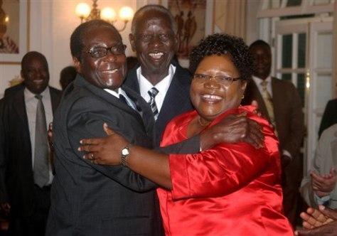 Image: Robert Mugabe, Joyce Mujuru, and Joseph Msika