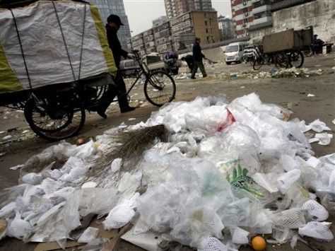 IMAGE: PLASTIC BAGS ON TRASH PILE