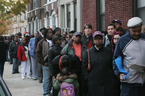 Image: Voters wait to cast ballots