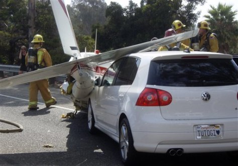 Image: Car hits plane after emergency landing