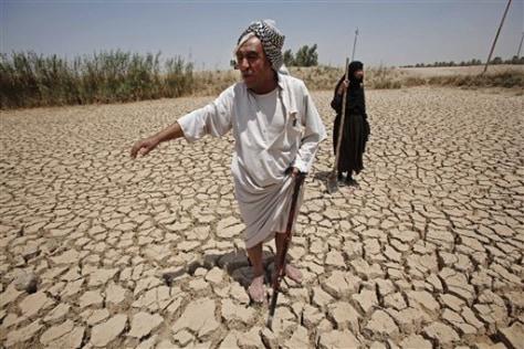 Image: Farmer on dried out farmland