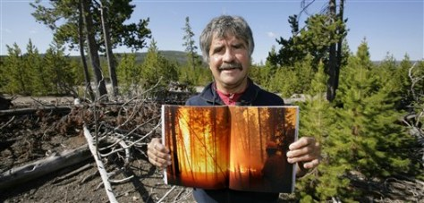 Image: Jim Henry with photo of 1988 fire