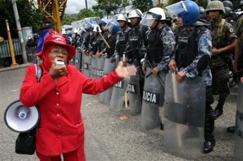 Image: Woman uses a megaphone
