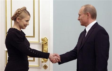 Image: Russian Prime Minister Vladimir Putin, right, greets Ukrainian Prime Minister Yulia Tymoshenko