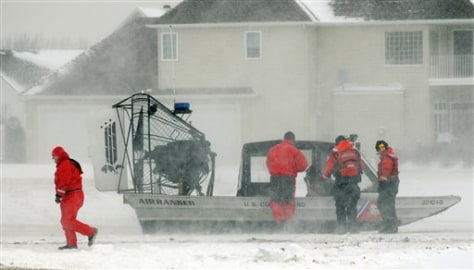 Image: U.S. Coast Guard evacuates residents
