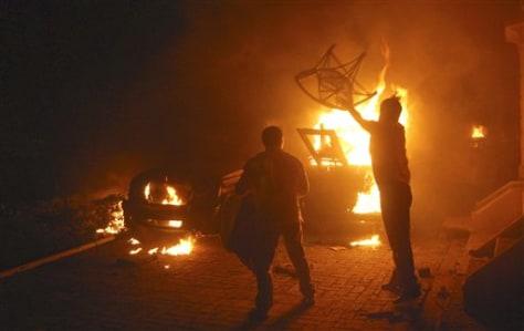 Image: Politician's belongings burned