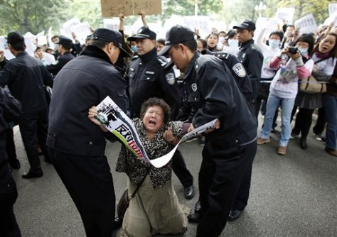 Image: Police hold a protestor