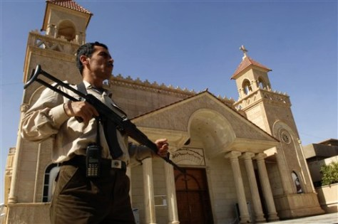 Image: A Christian man guards the Kirkuk Cathedral