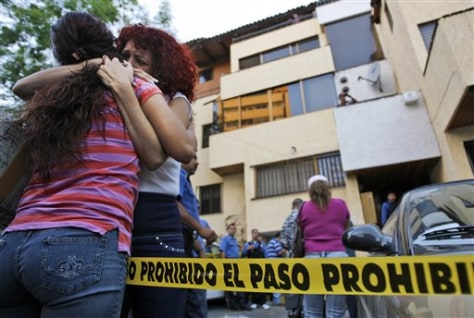 Image: Relatives at law office where six were killed in Guadalajara, Mexico