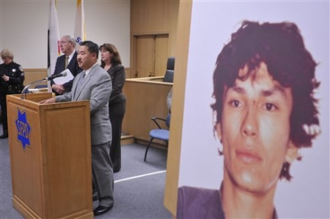 "Image: David Shinn, at podium, deputy chief of the San Francisco police department, beside a photograph of ""Night Stalker"" Richard Ramirez"