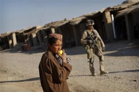 Image: Afghan boy and U.S. Marine