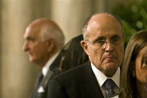 IMAGE: GIULIANI WAITS TO RECEIVE COMMUNION FROM POPE