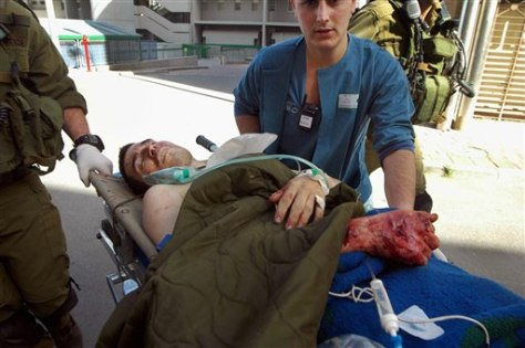 Image: Injured Israeli soldier is wheeled into hospital