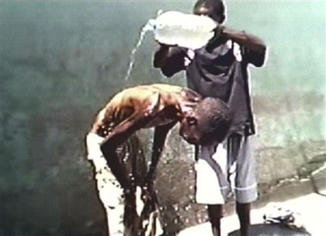 Image: Emaciated prisoner gets a wash