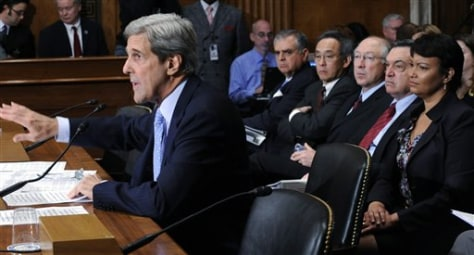 Image: Kerry testifies, Cabinet officials sit behind him