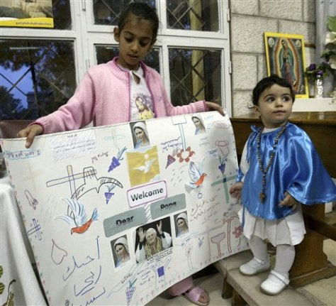 Image: Jordanian children hold welcome poster for pope