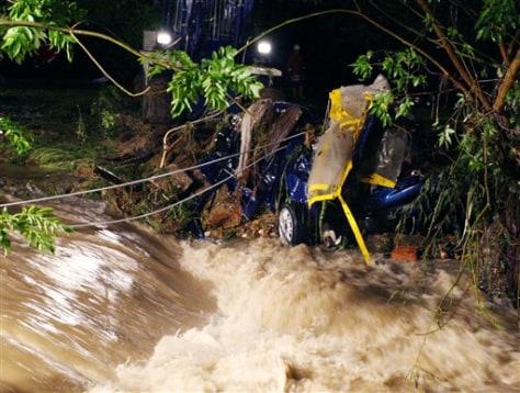 IMAGE: CAR DESTROYED BY FLOOD