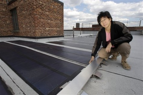 Image: Jillian Lung shows solar panels on roof