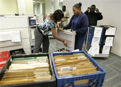 Image: U.S. Citizenship and Immigrations Services employees process documents