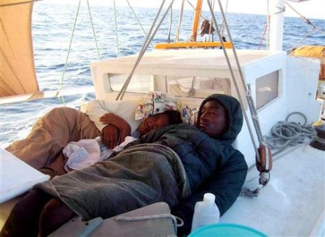 IMAGE: Haitians rest on deck