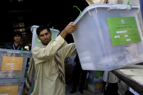 Image: Election worker unloads ballot boxes in Kabul, Afghanistan