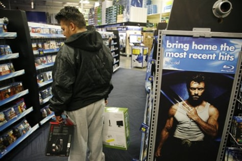 Image: Shopper looking at Blu-ray discs