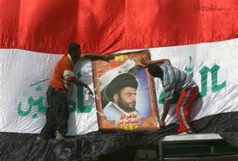 Image: Protesters with Muqtada al-Sadr poster