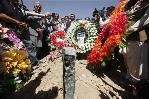 Image: Journalists at grave site of peer