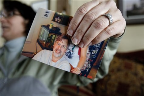 Image: Wife holds photo of Capt. Richard Phillips
