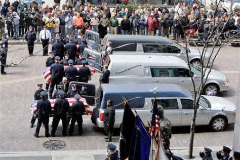 Image: Caskets of three slain Pittsburgh officers