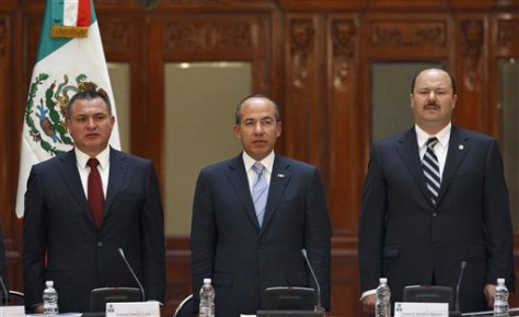 Image: Felipe Calderon, center.
