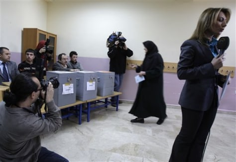 Image: Woman prepares to cast ballot