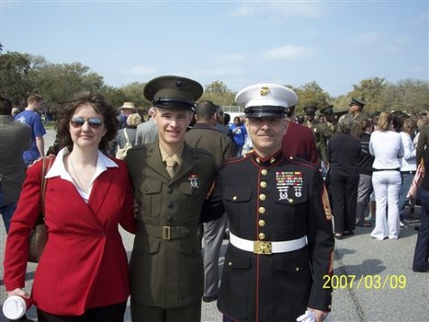 Image: Retired Marine 1st Sgt. John Bernard, right, with his wife Sharon, left and late son, Marine Lance Cpl. Joshua Bernard, center