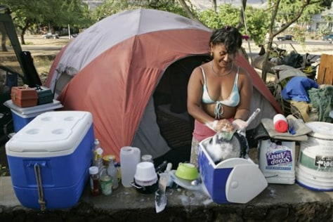 IMAGE: Auntie washes dishes at campsite