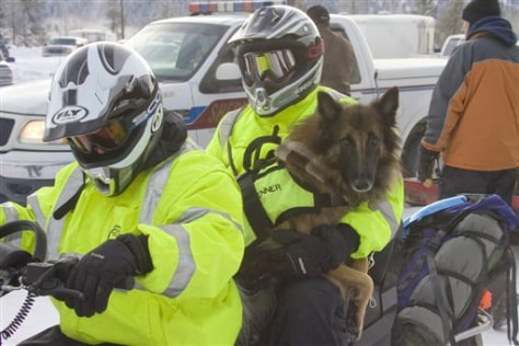 IMAGE: RESCUERS WITH DOG