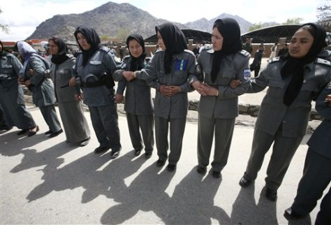 Image: Afghan female officers create barrier for protesters