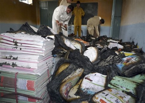 Image: Residents examine burned books