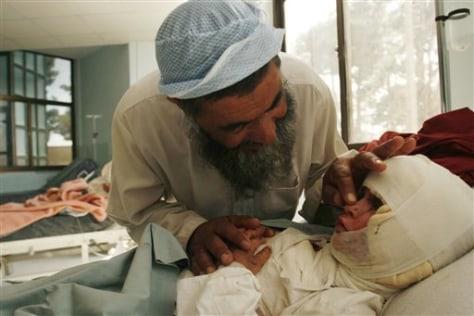 Image: Haji Barkat Ullah speaks with his daughter