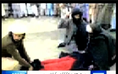 Image: Footage shows beating of woman in burqa
