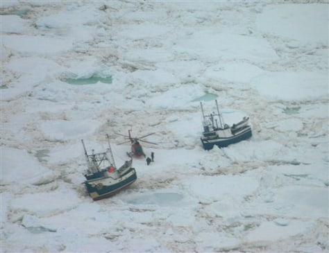 IMAGE: Helicopter and ice-bound sealing boats
